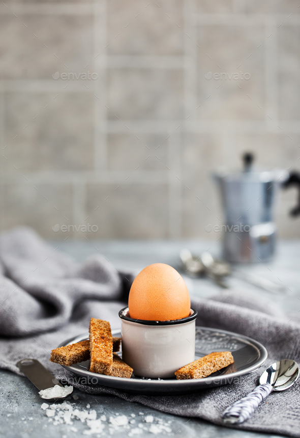 Boiled egg with rye toasts for breakfast - Stock Photo - Images