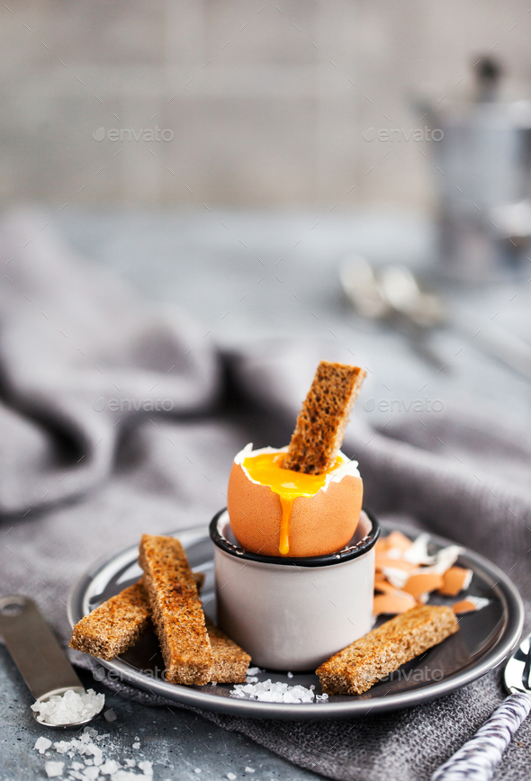 Soft boiled egg with rye toasts for breakfast - Stock Photo - Images