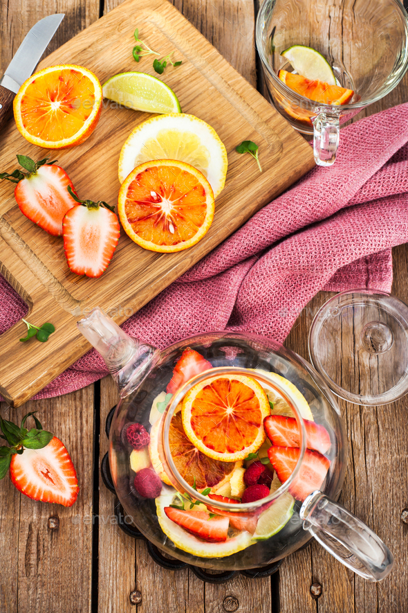 Fruit red tea with oranges and berries on wooden table, top view - Stock Photo - Images