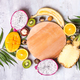 Fruits and palm leaves on stone background with wooden plate. Tropical fruits. Summer concept. Flat - PhotoDune Item for Sale