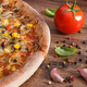 Vegetarian pizza and ingredients with spices on rustic board, fast food - PhotoDune Item for Sale