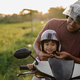 daddy help her daughter to fasten the helmet - PhotoDune Item for Sale