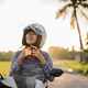 woman wearing and fasten her helmet while riding - PhotoDune Item for Sale