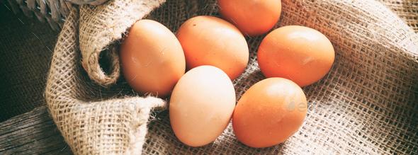 Raw organic farm eggs on burlap, banner - Stock Photo - Images