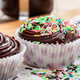 Cupcakes with colorful sprinkles, banner, closeup view - PhotoDune Item for Sale