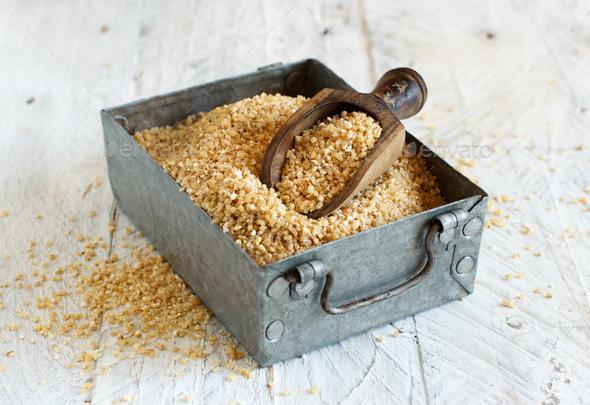 Dry bulgur wheat grains - Stock Photo - Images