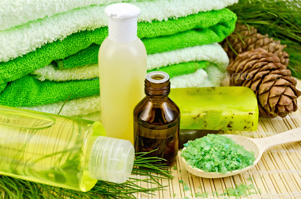 Oil and toiletries with cedar cones - Stock Photo - Images