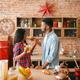Playful black couple having fun on the kitchen - PhotoDune Item for Sale