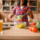 Black woman cooking salad on the kitchen - PhotoDune Item for Sale
