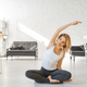 Yuong woman sitting on the floor in yoga pose - PhotoDune Item for Sale