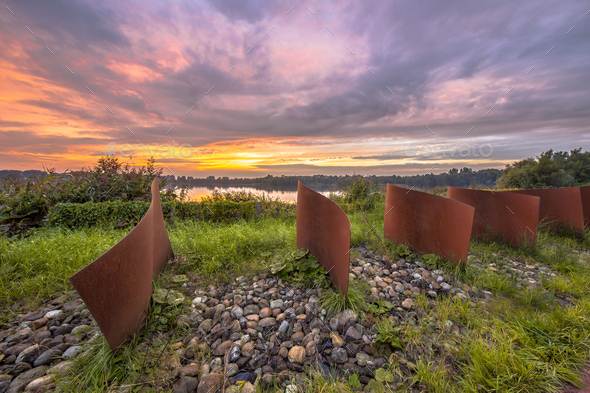 Metal waved objects in landscape - Stock Photo - Images