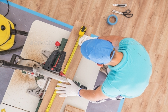 Flooring Contractor at Work - Stock Photo - Images