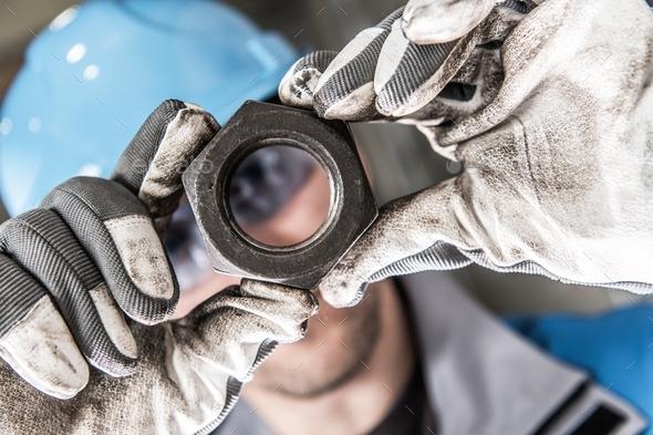 Metal Nut in Worker Hands - Stock Photo - Images
