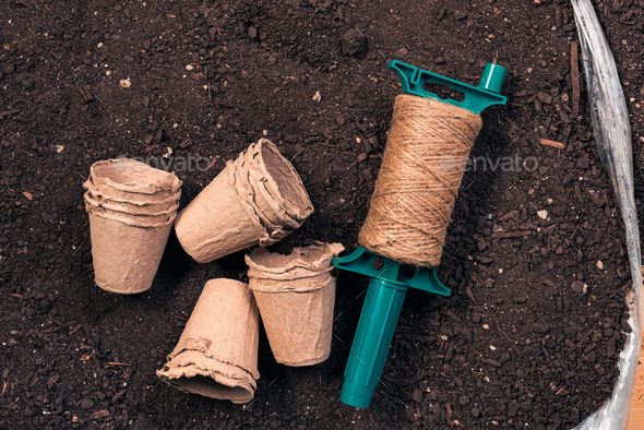 Biodegradable plant pots, jute rope and soil - Stock Photo - Images