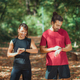 Young couple Looking at Their Smart Watches After Outdoor Training - PhotoDune Item for Sale