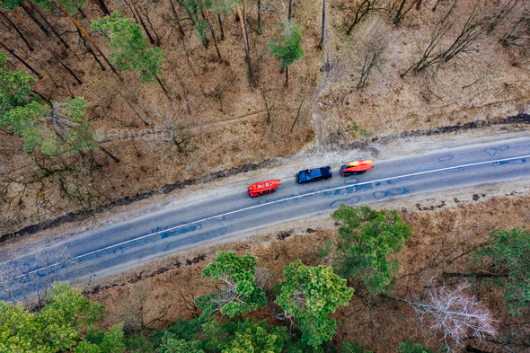 Several cars with kayaks on roof rack driving on the road among trees - Stock Photo - Images