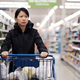 Asian woman doing groceries shopping in supermarket - PhotoDune Item for Sale