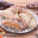 Traditional Spanish sweets with chocolate and caramelized fruits on a plate decorated on wood - PhotoDune Item for Sale