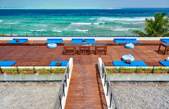Tropical beach with patio deck - Stock Photo - Images