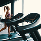 Blond young, motivated woman running on the treadmill in the gym - PhotoDune Item for Sale