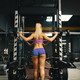 Back view, sporty girl in pink top and mini shorts, raising the bar preparing for squats - PhotoDune Item for Sale