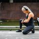Sporty Female Runner Listening Music On Headphones and Using Smartwatch - PhotoDune Item for Sale