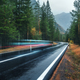 Blurred car on the road in spring forest in rain - PhotoDune Item for Sale