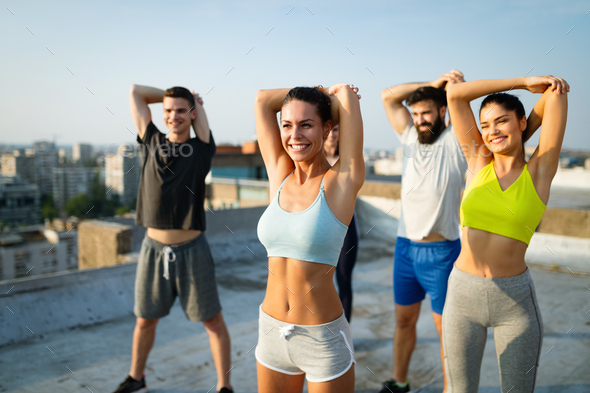 Fitness, sport, friendship and healthy lifestyle concept . Group of happy  people exercising Stock Photo by nd3000