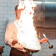 A man cooks cooking deep fryers in a kitchen fire. Blurred photo effect - PhotoDune Item for Sale