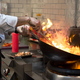 A man cooks cooking deep fryers in a kitchen fire. - PhotoDune Item for Sale