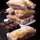 homemade sponge cakes and pieces of chocolate on dark classic wood - PhotoDune Item for Sale