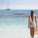 Girl stand in water looking to the sea, Saona - PhotoDune Item for Sale