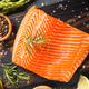 Salmon fillet with ingredients for cooking - fresh vegetables and spices on black - PhotoDune Item for Sale