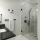 Modern bathroom with glass shower and marble tile. - PhotoDune Item for Sale