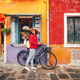Attractive girl with a bike in Italy - PhotoDune Item for Sale