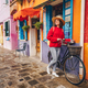 Smiling girl with a bike in Italy - PhotoDune Item for Sale