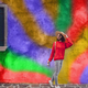 Smiling girl on the background of a colored wall - PhotoDune Item for Sale