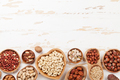 Various nuts selection on wooden table - PhotoDune Item for Sale