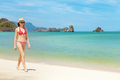 Young attractive woman walking on the sea beach - PhotoDune Item for Sale