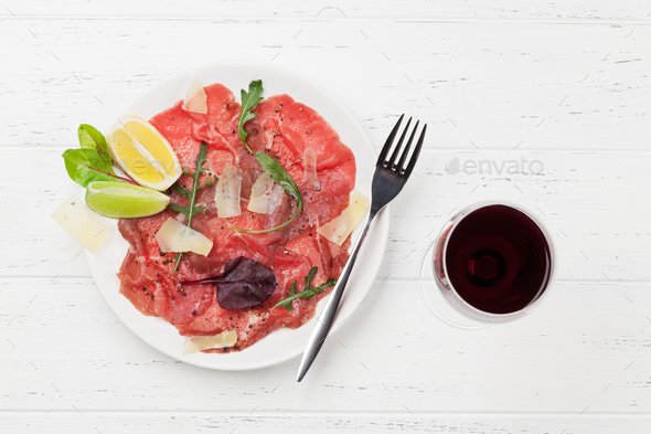 Marbled beef carpaccio and red wine - Stock Photo - Images
