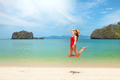 Young attractive woman jumping on the sea beach - PhotoDune Item for Sale