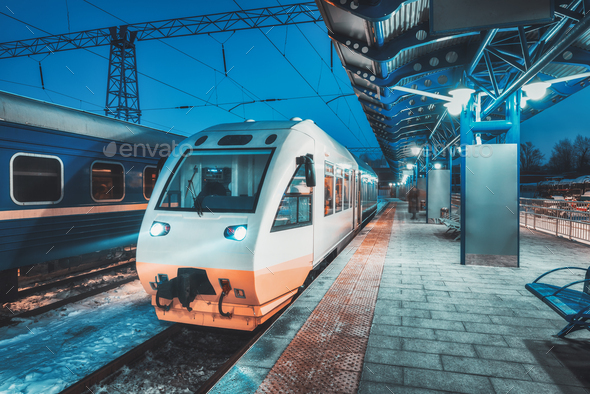 White high speed train on the railway station at night - Stock Photo - Images