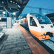 High speed train on the railway station at night - PhotoDune Item for Sale