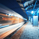 Blurred high speed train on the railway station at night - PhotoDune Item for Sale
