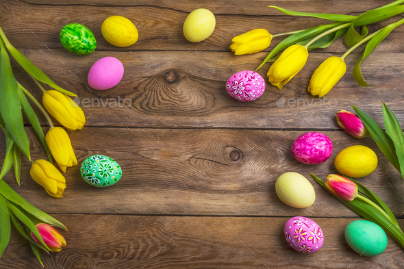 Easter rustic background with pink, yellow and green painted egg - Stock Photo - Images