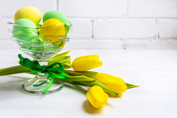 Easter green eggs, yellow tulips, copy space - Stock Photo - Images