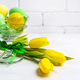 Easter green eggs, yellow tulips, copy space - PhotoDune Item for Sale