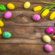 Easter rustic background with pink, yellow and green painted egg - PhotoDune Item for Sale