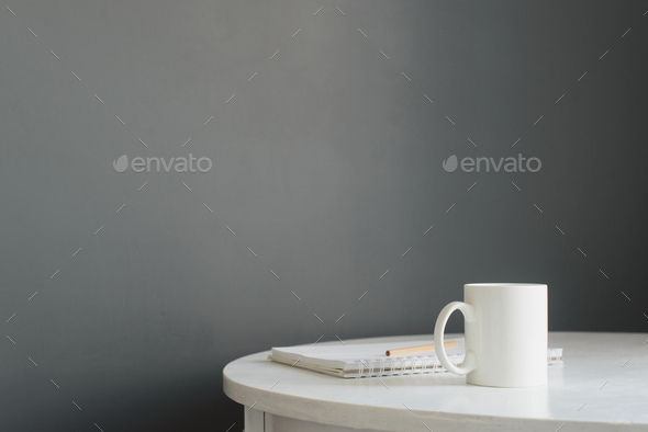 white ceramic coffee cup with notepad and pencil on wooden table - Stock Photo - Images