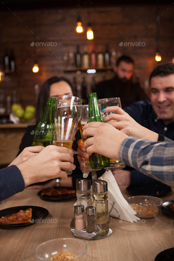 Group of happy friends drinking and toasting beer at brewery bar restaurant - Stock Photo - Images